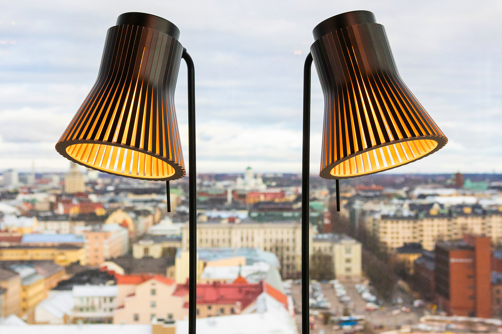 Petite floor lights with the autumnal Helsinki at the back. Photo by Teemu Reunila.